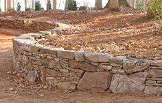 link includes several other prime examples of retaining walls using larger rocks to add interest to the wall