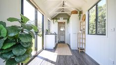 With its single level design and exposed rafter ceilings, the Coolum by Aussie Tiny Houses offers a simple yet stylish living space. Tiny Houses For Sale, Tiny House On Wheels, Little Houses, Exposed Ceilings, Exposed Rafters, Square Windows, Tiny House Living, Small Living, Tiny Spaces