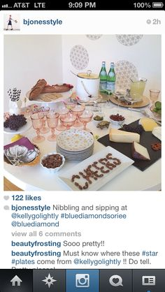"""Nice party table. Not too fussy, but very cute. Love the chalk board cheese plate and the almonds spelling """"cheers"""""""
