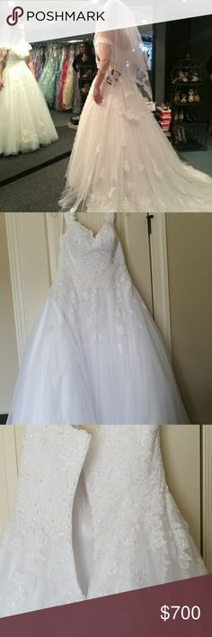 Gorgeous Wedding Gown by Essence Offers accepted. Worn last year this gown is still in style. Cost $1850.What a deal! 🌷 Essentials of Australia with intricate beading crystal button up back and A Line dress with trail behind dress in white about 15 feet long. 100% polyester. US size 14. Altered added cups sewn in easily removed. Under side of slip has small amount of black not noticeable on under side of protective slip. It has a protective bag included. Essense of Australia Dresses Wedding