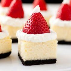 Santa Hat Cheesecake Bites - white chocolate cheesecake, oreo crust, whipped cream and a fresh strawberry.