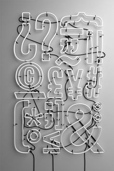 Neon sign, white electric typography with symbols including question mark, astrick, and an ampersand. Typomad on Behance. Typography Letters, Graphic Design Typography, Typography Served, Types Of Lettering, Hand Lettering, Typographie Inspiration, Wayfinding Signage, Environmental Graphics, Vintage Design