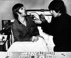 George visiting Ringo in the hospital when he had his tonsils removed Dec of 1964 Ringo had to miss tour dates, and he missed being with John, Paul & George.