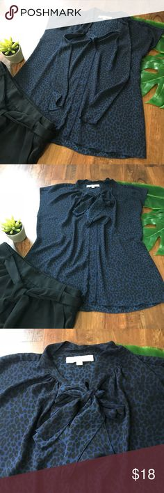 """Ann Taylor Top Tie Blouse Excellent condition with no rips, stains or snags.  Black and blue cheetah print.  Top ties into a bow or a knot.  Size medium.  Armpit to armpit it's approximately 19"""".  Shoulder to bottom is approximately 25"""".  100% polyester. Ann Taylor Tops Blouses"""