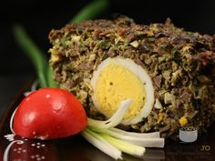Baked minced lamb stuffed with boiled egg (drob de miel)