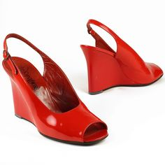 #bornonthisday in 1936, Yves Saint Laurent is regarded as one of the most iconic fashion designers of the twentieth century.  His skill is illustrated by the timelessness of these open toe, sling back red patent leather shoes from mid-1970s.  #batashoemuseum #bsm #YvesSaintLaurent #YSL #bornonthisday #fashiondesigner #shoedesigner #fashionicon #fashionshoe #fashionhistory #shoemuseum #shoehistory