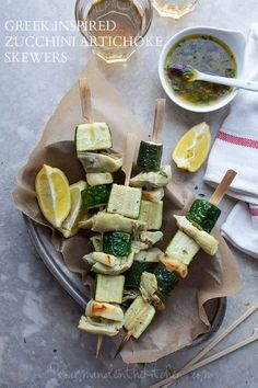 Zucchini, artichokes and halloumi team up with a zesty lemon oregano marinade in these easy Greek inspired vegetable skewers.