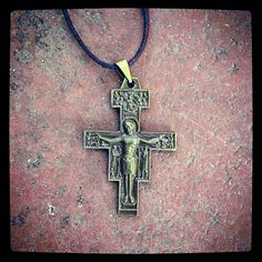 """The San Damiano Crucifix is the Byzantine icon through which Jesus spoke to St. Francis of Assisi saying, """"Francis, rebuild my Church, as you see it is falling to ruins."""" It is a symbol for all Christians who dedicate themselves to the work of renewing the Church, namely by being the Church - the """"living stones"""" of God's house. $8"""