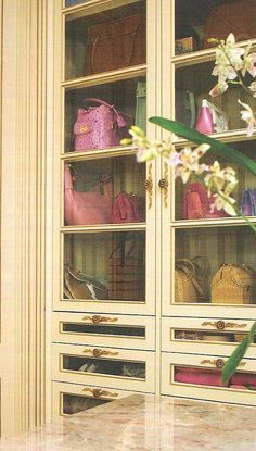 accessory storage... could be a built-in or freestanding armoire | Charles Faudree via Traditional Home