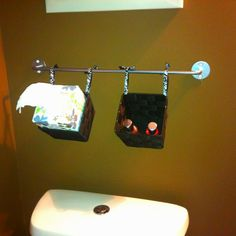 A perfect fix for the Kleenex and air fresheners that continuously fall off the toilet! All under $5 bucks for each bathroom. (Ikea for the rod, dollar store for the baskets and michaels for the ribbon!)