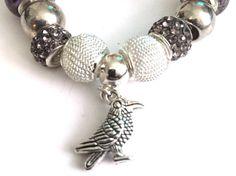 European Style Charm Bracelet With Raven Charm #europeancharmbracelet #raven #handmadejewellery #prandski