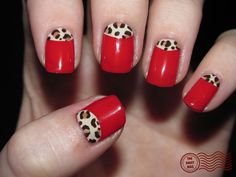 Red nails with leopard half moons....cute but I think I would do leopard tips instead