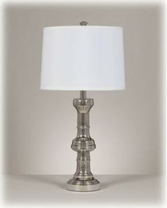 Shiny silver finished metal table lamp