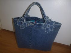Looking for your next project? You're going to love Denim Flower Power Purse by designer RoxanneStitches.