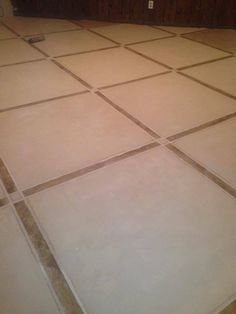 The classic tile look never gets old, a combination of browns and whites can creat a calm and neutral feel to any room.  This tile look was used to imitate real tiles on a concrete floor.