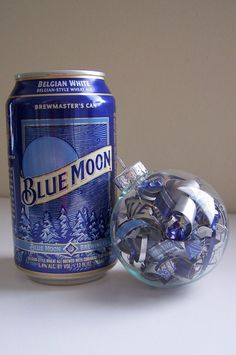 A clear glass ornament was filled with spirals hand cut from Blue Moon Belgian White beer cans. The ornament has a 3 inch diameter and is ready to ship. It arrives in a box suitable for gift giving.
