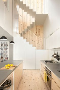 Wood on the floor and the wall, accentuating the depth and hight of the space