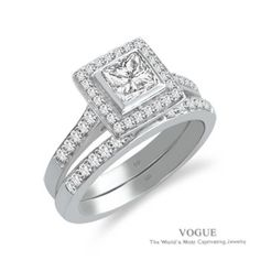 Say Yes to this Beautiful 14K White Gold Diamond Halo Engagement Ring with pristine accent diamonds.
