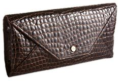 Always been mad for bags and shoes with croco embossing ............love the texture and the simple lines of this clutch.