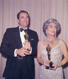 """1963 Oscars: Gregory Peck, Best Actor 1962 for """"To Kill a Mockingbird"""" and Joan Crawford (accepting Best Actress Oscar for Anne Bancroft for """"The Miracle Worker"""")"""