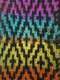 Mosaic Knitting Swatch.  I like how a variegated yarn has been used with black.  Mosaic is a technique of combining colours, but unlike intarsia/fairisle, you're only actually knitting with one colour on each row.