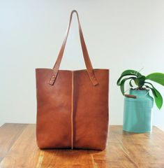 KAH says: simple bag, option to add a zipper.