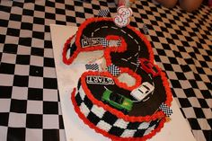 "Finn's number ""3"" Race car race track cake."
