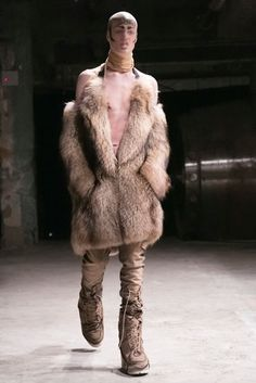 """The show, though nominally men's wear, included some women's looks and female models, though the stockings made it hard to tell who was (or identified as) what. Was that a conscious choice, Shayne Oliver, the designer, was asked backstage. """"Definitely,"""" he replied."""