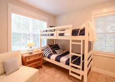 Pictured are two twin size bunk beds and twin size futon.