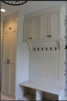 MUD ROOM WITH GREAT STORAGE FOR BROOM, IRONING BOARD, ETC