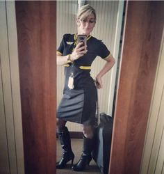 Image may contain: 1 person, standing, shoes, phone and indoor Crotch Boots, Flight Attendant Life, Pantyhose Outfits, Military Women, Lovely Legs, Cabin Crew, Dress With Boots, Leather Skirt, Sexy Women