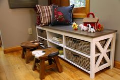 A convenient and cozy storage bench with cute kid-friendly stools. Designed and built by Paul Lafrance Design.