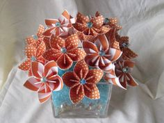 Tangerine and turquoise paper flower arrangement. $52.00, via Etsy.