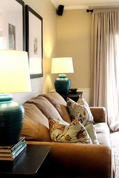 love the blue lamps, and the color in this living room.