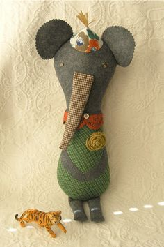 I have made many of these elephants for baby gifts.. The name I chose is Gorgeous George!