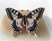 Dark Orange Butterfly Polymer Clay Necklace. $16.00, via Etsy.