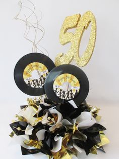 Customized 45 records, with Metallic Tissue Base & Optional Number cen – Designs by Ginny 50th Birthday Themes, 50th Birthday Centerpieces, Music Theme Birthday, Happy 50th Birthday, 60th Birthday Party, Party Centerpieces, Birthday Party Decorations, 50s Theme Parties, 70s Party