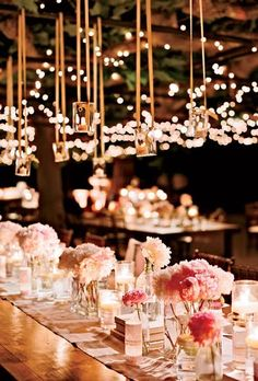 Love the lights and colors. Similar feel without the hanging votives would be perfect. Multiple arrangements of full peonies.
