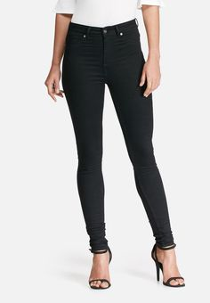 Made from a stretch fabric with support where it counts, these high-waisted jeggings feature a skinny shape with pocket details at the front and a zipper fly. Wear them with a bodysuit and heels for a head-turning night-out look, or simply pare them down with an oversized knit and sneakers. Pocket Detail, Jeggings, Stretch Fabric, Turning, Stretches, Night Out, Black Jeans, Bodysuit, Zipper