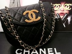 CHANEL SINGLE FLAP-BAG JUMBO COCO LOGO  ********CLASSIC COCO FLAP BAG********   ****RHIANNA CELEBRITY CHANEL OWNED HANDBAG****  PERFECT BLACK CHANEL = £1875   CHANEL GOLD CHAIN QUITED FLAP PURSE CROSS-BODY A WONDERFUL PREOWNED HANDBAG THAT HAS BEEN WELL LOVED SEE ALL PHOTOS.....OR MESSAGE FOR MORE DETAILS...   DESCRIPTION = RHIANNA CELEB FAVORITE FLAP BAG  CLASSIC CHANEL FLAP ...BLACK LAMBSKIN 1990S CHAIN STRAP BAG  Quilted leather composes this authentic vintage Chanel bag. Jumbo…