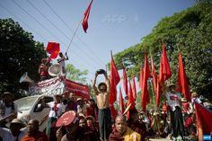 MYANMAR, Letpadan : Myanmar students shout slogans during a protest march in Letpadan town, some 130 kilometres (80 miles) north of  Myanmar's main city Yangon on March 4, 2015. Students have rallied for  months over a controversial education bill that they say is undemocratic  and have collected support from ordinary people and monks in their  march, which began in the central city of Mandalay in January. AFP PHOTO  / Ye Aung THU