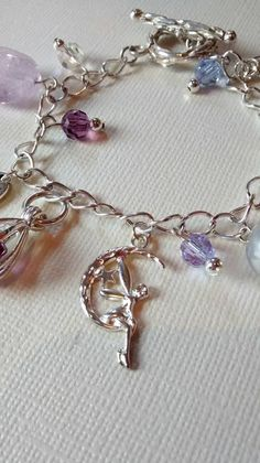 Check out this item in my Etsy shop https://www.etsy.com/uk/listing/285631865/fairy-and-butterfly-charm-bracelet-in