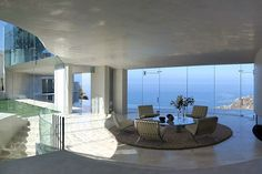 Located on a 10,000sqf site, the house is a once-in-a-lifetime opportunity. Designed by one of Architectural Digest's Top 100 Designers, the building is mainly made out of white, polished concrete, steel and glass which allows you to soak in the breathtaking views of the ocean.  This contemporary house hosts four bedrooms, six bathrooms, a kitchen, living and dining areas, courtyard and a beautiful swimming pool. The furniture throughout the entire house is very modern, but simple, leaving…