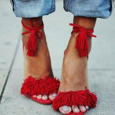 Red SASSEY sandal with fringes, tassels and lace up.   STEVE MADDEN EUROPE
