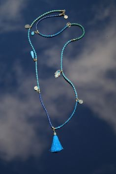 Exoal's Ibiza necklace - Blues, green and turquoise stones, gold plated beads and beautiful detailed charms and silk tassel. 56cm