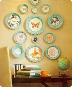 spray paint pie pans, circle baskets, etc. all one color and decoupage pretty paper and clipped photos