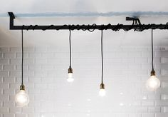 Handmade Industrial style light. It is consisted of a 1.20metres pi shaped black bar that it can be custom made in other lengths too. a 4 light or
