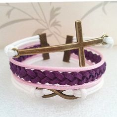 Infinity Bracelet.Cross Bracelet-White Pink Wax Cords and Purple Braid bracelet.Popular Bracelet. $7.99, via Etsy.