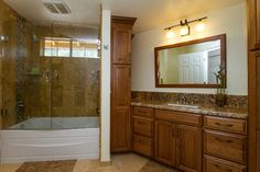 large Steam Shower. In the upstairs guest bath (tub/shower combo,) we took a space that was once divided into 3 awkwardly shaped compartments, (vanity area, toilet and tub room, linen closet) and combined them to make a very large, and functional guest bathroom.