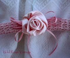 Fabric rose on a crochet hanger